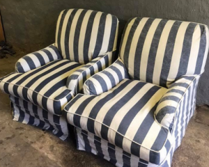 Two modern contemporary blue and white denim striped sofa chairs